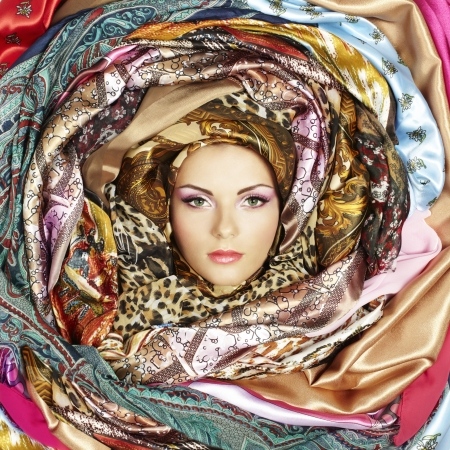 Young woman face with scarves.