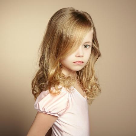 Portrait of pretty little girl. Fashion photo