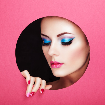Conceptual beauty portrait of beautiful young woman. Perfect Manicure.  Cosmetic Eyeshadows. Fashion photoの写真素材