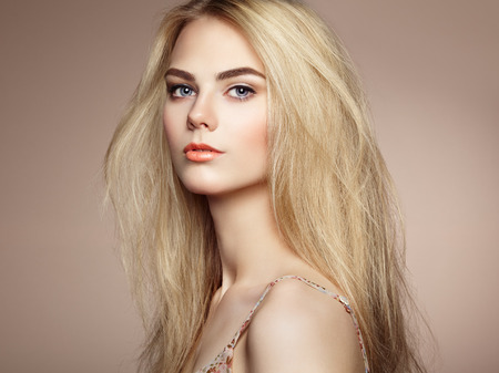 Fashion portrait of elegant woman with magnificent hair. Blonde girl. Perfect make-up. Hairstyle