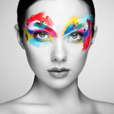 Foto de Beautiful woman face. Perfect makeup. Beauty fashion. Eyelashes. Cosmetic Eyeshadow - Imagen libre de derechos