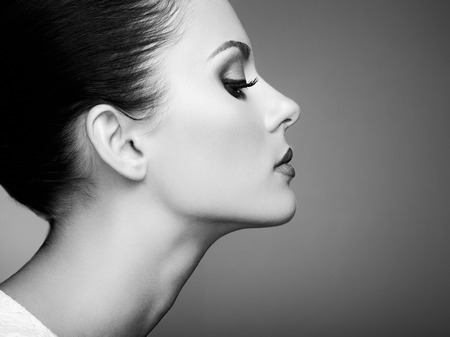 Beautiful woman face. Perfect makeup. Beauty fashion. Eyelashes. Cosmetic Eyeshadow. Black and white