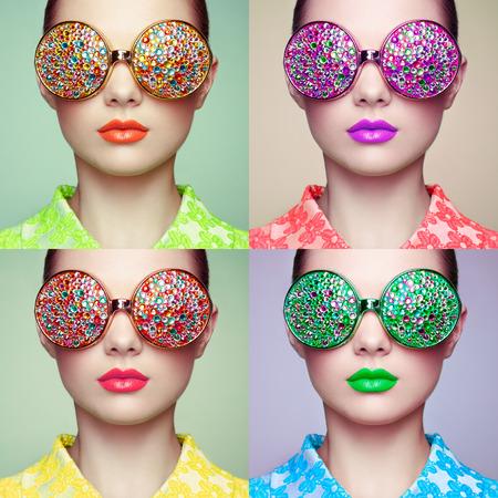 Foto de Portrait of beautiful young woman with colored glasses. Beauty fashion. Perfect make-up. Colorful decoration. Jewelry - Imagen libre de derechos