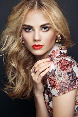 Foto de Portrait of beautiful sensual woman with elegant hairstyle.  Perfect makeup. Blonde girl. Fashion photo. Jewelry and dress - Imagen libre de derechos
