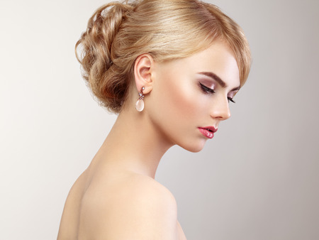 Photo for Portrait of beautiful sensual woman with elegant hairstyle.  Perfect makeup. Blonde girl. Fashion photo. Jewelry and dress - Royalty Free Image
