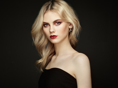 Portrait of beautiful sensual woman with elegant hairstyle.  Perfect makeup. Blonde girl. Fashion photo. Jewelry and dressの写真素材