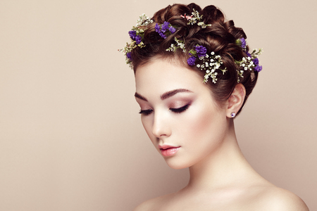 Photo pour Face of beautiful woman decorated with flowers. Perfect makeup. Beauty fashion. Eyelashes. Cosmetic Eyeshadow - image libre de droit