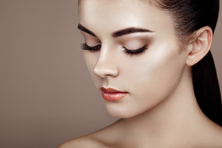 Beautiful woman face. Perfect makeup. Beauty fashion. Eyelashes. Cosmetic Eyeshadow. Highlightingの写真素材