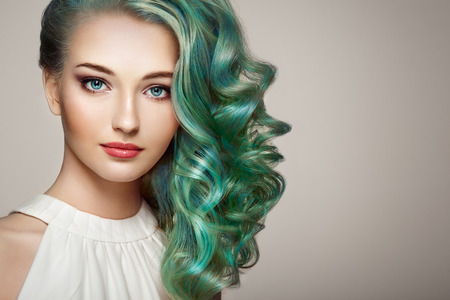 Photo pour Beauty fashion model girl with colorful dyed hair. Girl with perfect makeup and hairstyle. Model with perfect healthy dyed hair - image libre de droit
