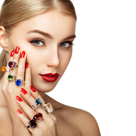 Foto de Portrait of beautiful woman with jewelry. Manicure and makeup. Perfect skin. Fashion beauty. Ring. Blonde girl. Close up - Imagen libre de derechos