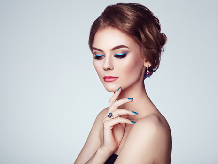 Photo pour Portrait Beautiful Woman with Jewelry. Model Girl with Blue Manicure on Nails. Elegant Hairstyle. Blue Make-up Arrows. Beauty and Accessories - image libre de droit