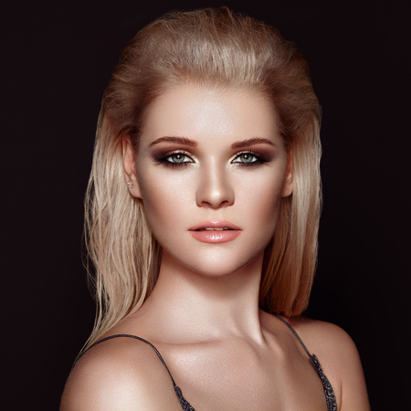Blonde Girl with Long and Shiny Hair. Beautiful Model Woman with Smooth Hairstyle. Care and Beauty Hair products. Perfect Make-Up. Makeup Look for Parties