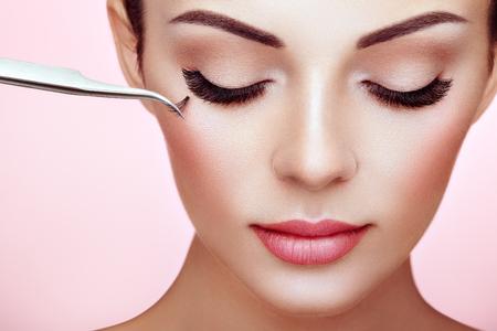 Beautiful Woman with Extreme Long False Eyelashes. Eyelash Extensions. Makeup, Cosmetics. Beauty, Skincare. Woman Glues Eyelashes