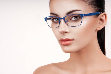 Photo pour Woman with long eyelashes in eyeglasses. Vision correction. Poor eyesight. Spectacle frame. Makeup, cosmetics, beauty. Close up, macro - image libre de droit