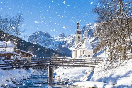 Photo for Snowfall in Ramsau, the parish church Saint Sebastian in winter, Ramsau, Berchtesgaden, Bavaria, Germany - Royalty Free Image