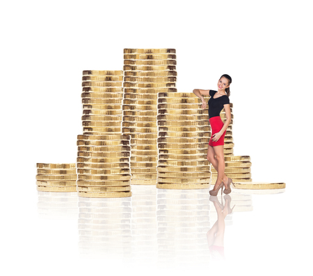 Business woman near stack of golden coins isolated on the white background