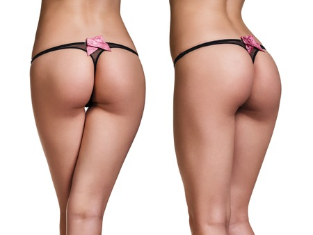 Perfect female buttocks in black thong isolated on whit background