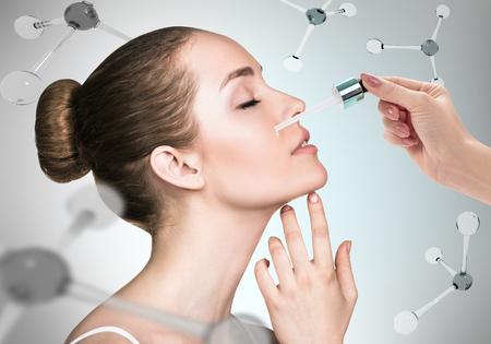 Photo pour Cosmetics oil on face among the molecules - image libre de droit