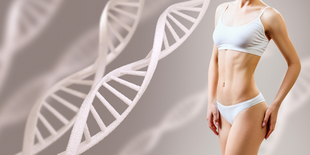 Photo for Perfect sporty female body near DNA stems. Good metabolism concept. - Royalty Free Image