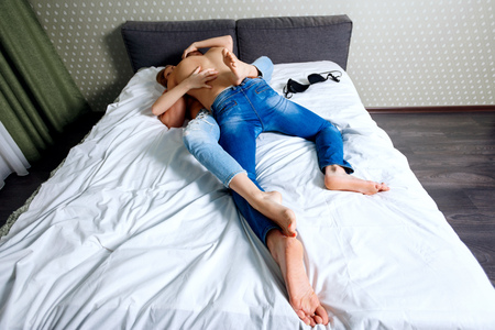 Photo pour Top view on young couple playing on bed. - image libre de droit
