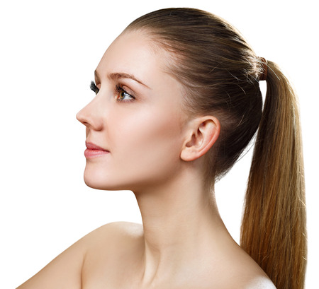 Photo pour Side view on beautiful female face with perfect skin. - image libre de droit