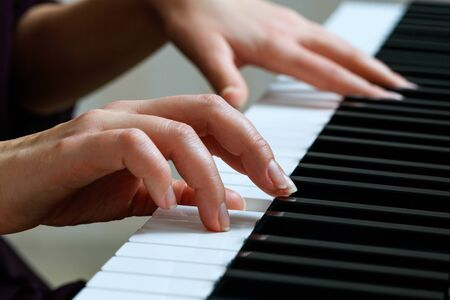 Photo for Young woman playing piano - Royalty Free Image