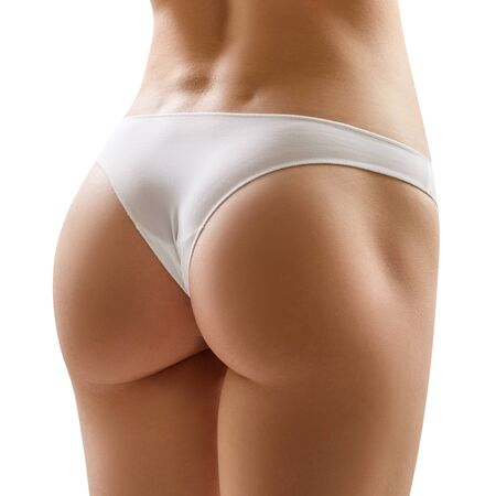Photo for Perfect buttocks of young woman in white panties. - Royalty Free Image