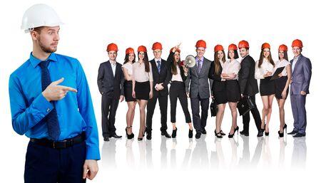 Photo pour Man point finger on people with helmets on head. - image libre de droit