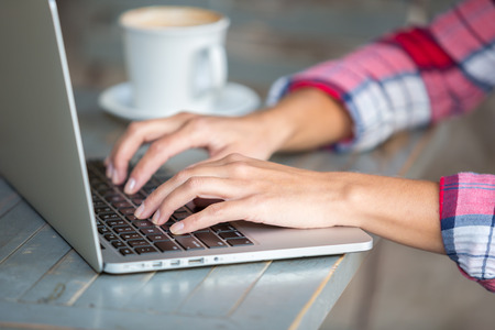 Photo pour Woman hands typing on laptop - image libre de droit
