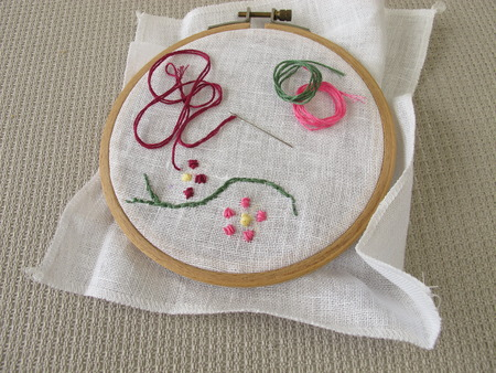 Embroidery with flower tendril