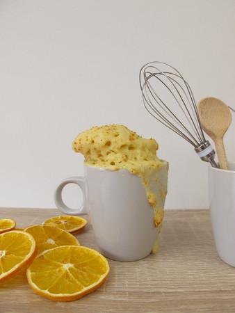Orange cake, mug with a glass of orange sugar
