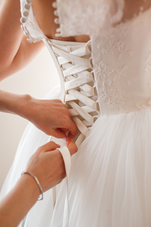 Foto de Bridal fees, preparation to wedding day. Wedding dress details, close up. - Imagen libre de derechos