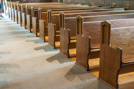 Photo for A row of antique  wooden church pews. - Royalty Free Image