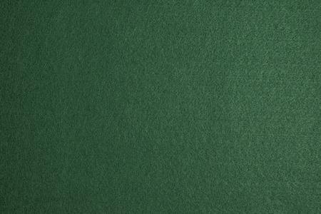 Green felt surface of a gambling table