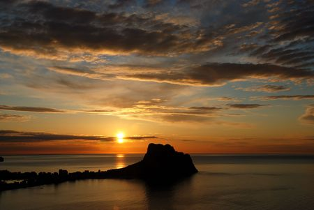 The sun raising on Calpe, a popular Mediterranean holiday ressort.