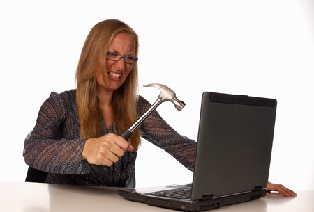 Furious secretary attempting to trash her hated laptop