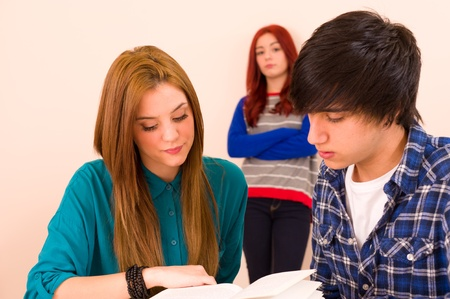 Jealous girl watching their classmates
