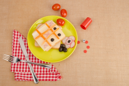Ham and cheese sandwich attractively decorated for children