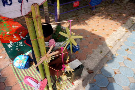 Thai toys made from palm leaves sell in temple festival