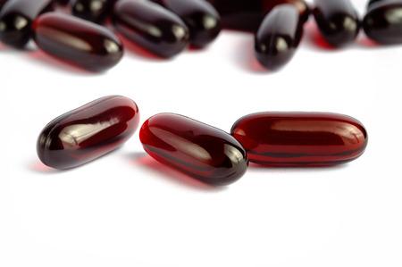 Photo pour Krill oil omega 3 capsules over white background - image libre de droit