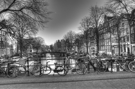 Canal bridge view with bicycles in Amsterdam, Netherlands