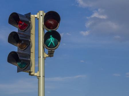 Photo pour traffic light - semaphore - green walking figure puppet on blue sky background - image libre de droit