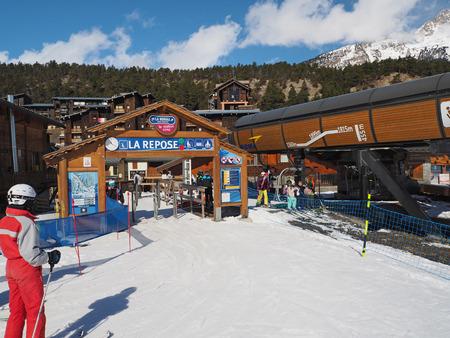 LA NORMA, FRANCE,  MARCH 5, 2017: People using ski lift La Repose in sky resort La Norma Savoyan Alpes