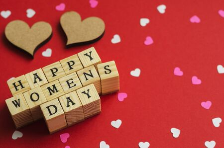 Photo pour happy womens day folded from wooden cubes with letters 8 - image libre de droit