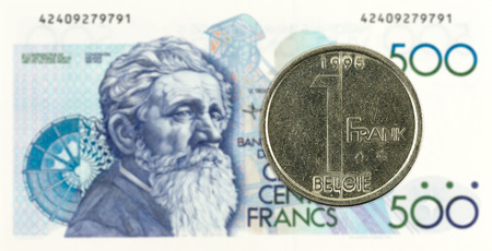 1 belgian franc coin against 500 belgian franc note