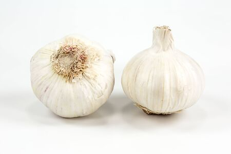 Photo pour two closed white organic garlic bulbs with skin isolated on white background - image libre de droit