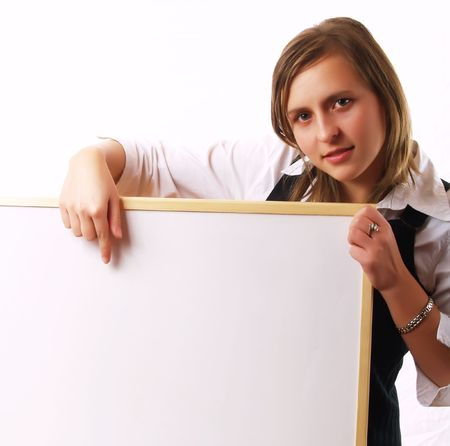 Young woman holding and showing a wite board, with a copy-space