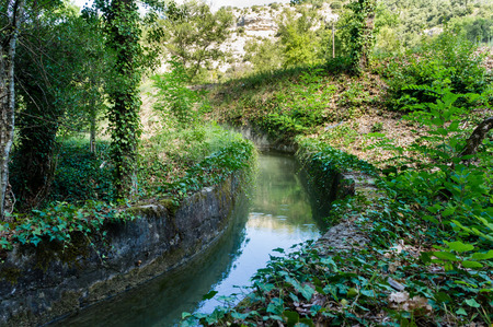 Hidden small canal in Greoux les Bains bringing water to the thermal baths.
