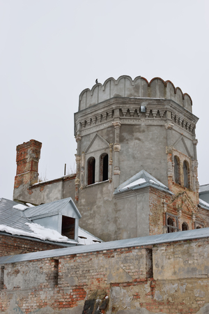 Old crumbling building - the tower in the Feodorovsky village in Pushkin, the Academic prospect 18, St Petersburg