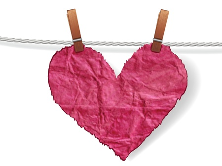 Heart crumpled ragged attached to a clothesline with pin. Love concept for valentine day.